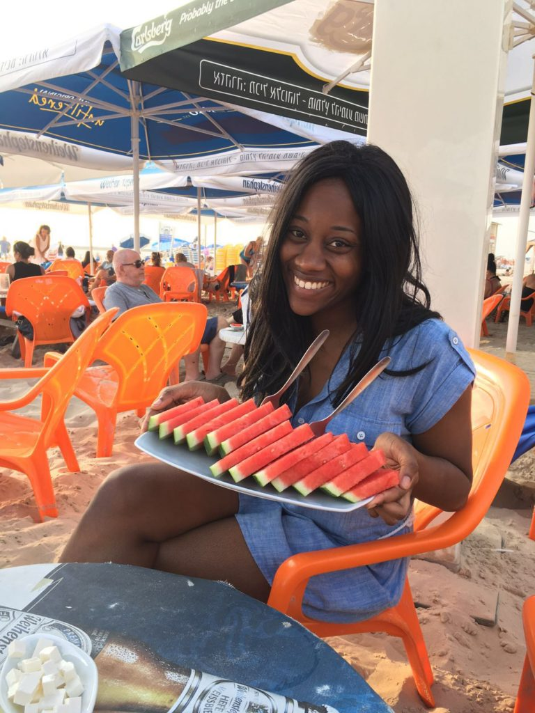 food, a person smiling, beach chairs and fruit