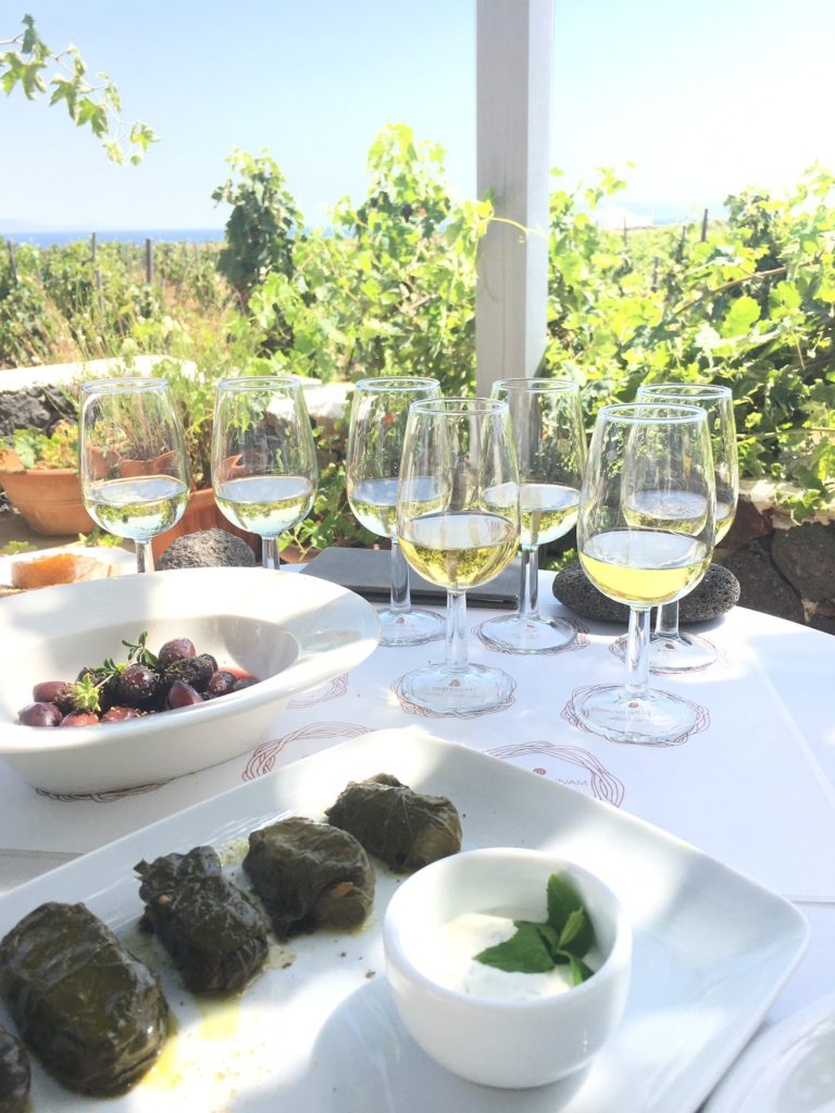 glass of wine and food in a Vineyard at Oia Santorini