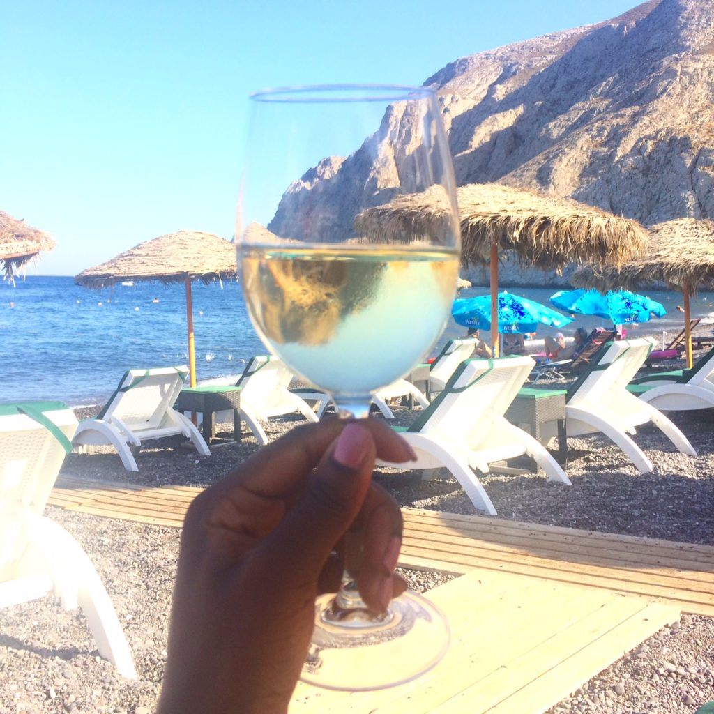 glass of white wine at Kamari beach Santorini