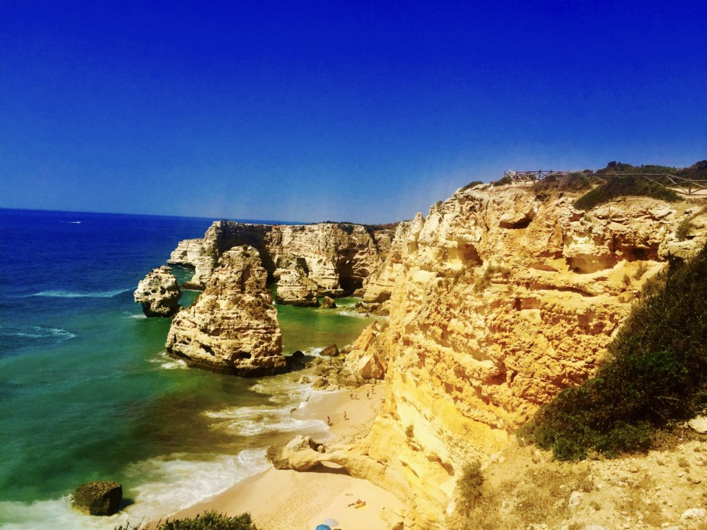 blue sky, blue water and cliffs in Algarve Portugal