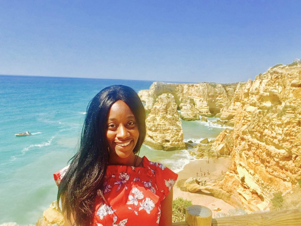 black lady travel blogger at Praia de Marinha Algavre Portugal
