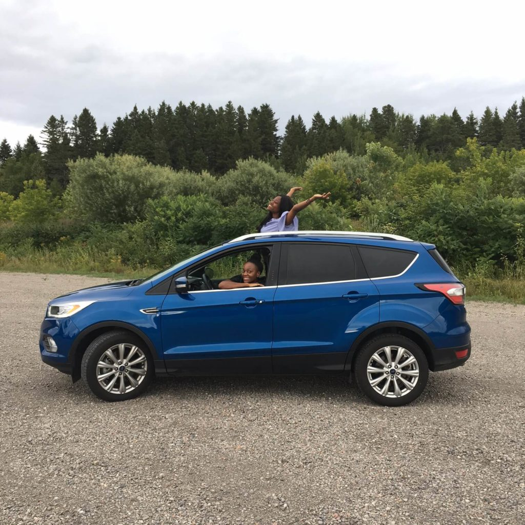 two persons inside 2017 Ford Escape Titanium car